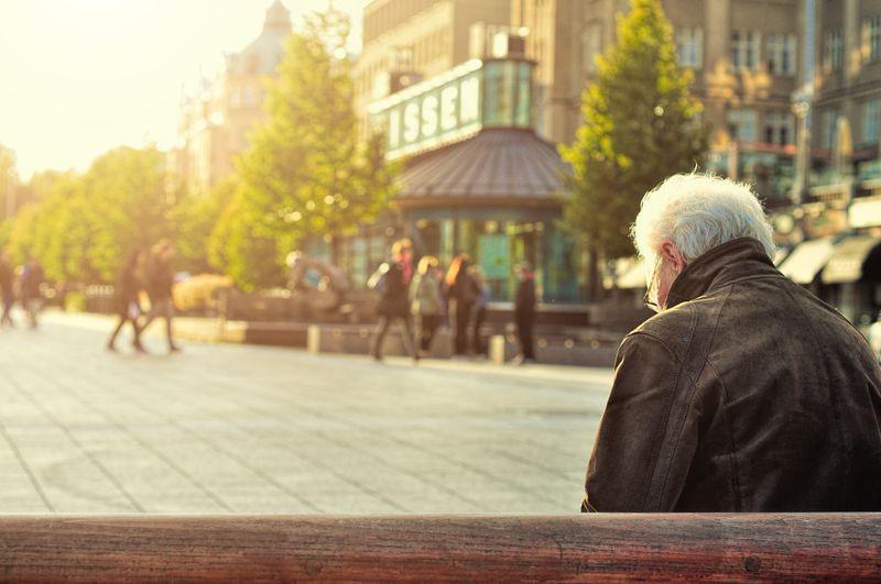 senior sitting outside