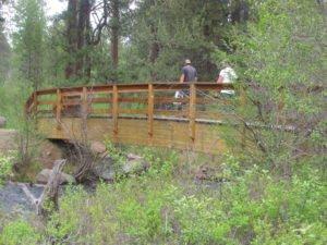 Men crossing bridge