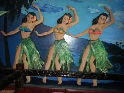 Polynesian dancers on wall