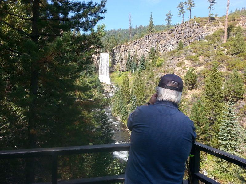 Man taking photo of falls