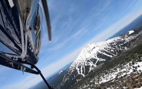 Helicopter over snowy mountain