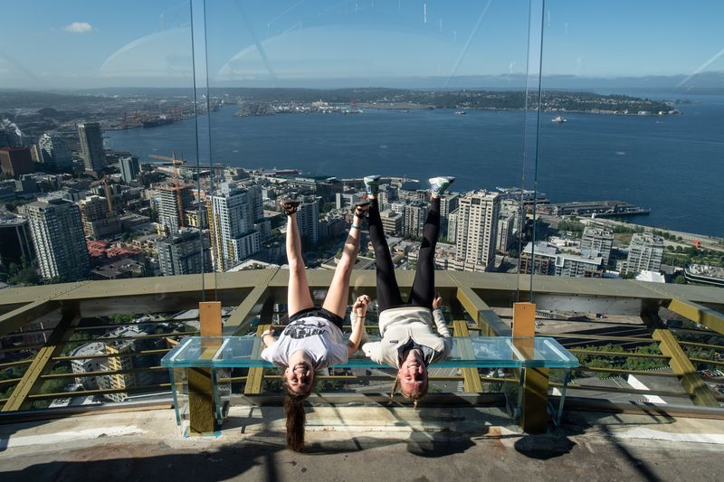 Two people upside down on space needle