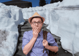 Man covers mouth with snow background