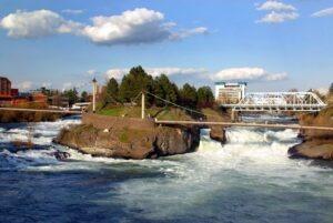suspension bridge over waterfalls