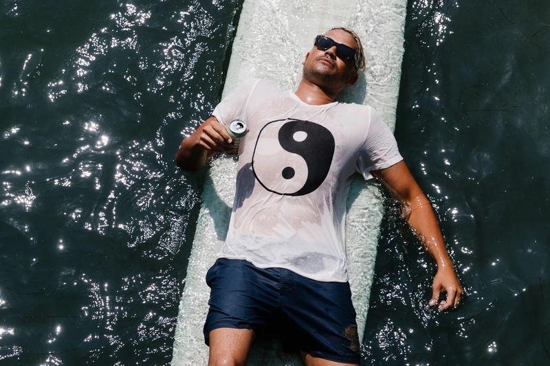 Man with ying yang shirt