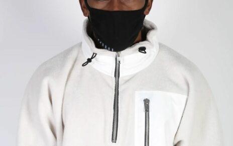 Man wearing white coat and mask