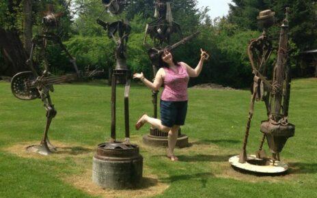 Woman prancing in metal garden