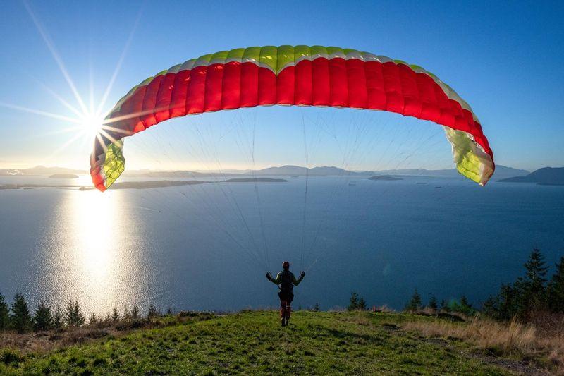 Paraglider over ocean